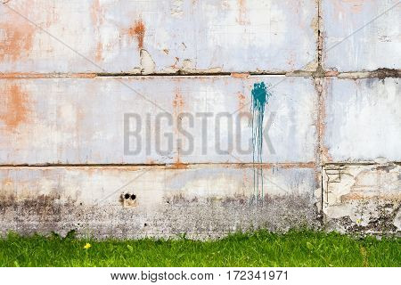 Concrete block wall and with green grass