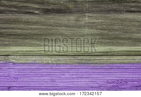 surface of an old wooden board. Half shaded pink paint.