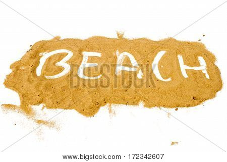 Word BEACH written on pile of yellow sand isolated on white background selective focus at center