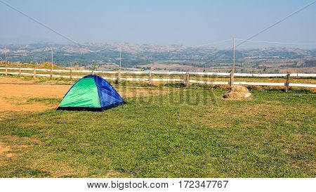 Tourist tent camp on the lawn on the highest point of the mountain.