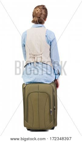 back view of woman  in vest sits on a suitcase. beautiful  girl in motion.  backside view of person.  Rear view people collection. Isolated over white background.