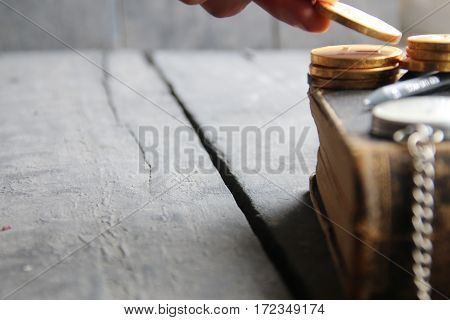 Tuition fees concept, old book on wooden vintage table
