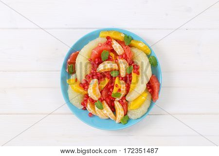 plate of fruit salad on white background
