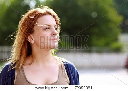 portrait of adult woman looking into the distance outside