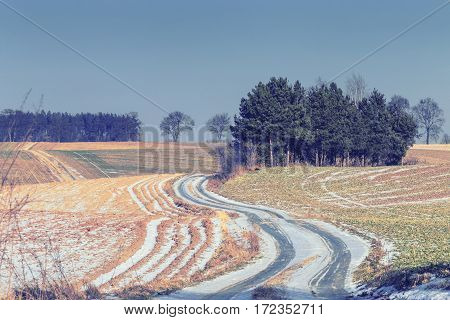 Curvy Countryside Road Across Farmland in Winter