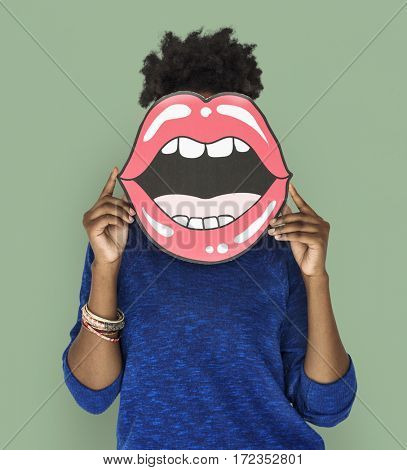 African Woman holding Paper Mouth Over her Face