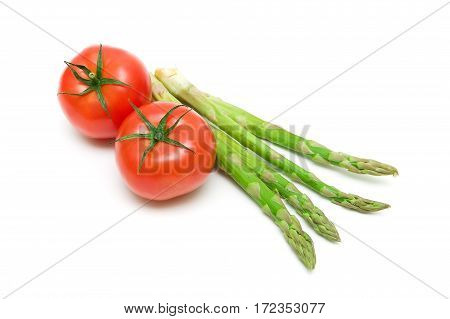 tomatoes and asparagus on a white background close-up. horizontal photo.