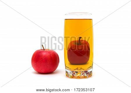 glass of juice and ripe red apple isolated on a white background. horizontal photo.