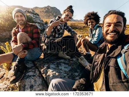 Hikers Relaxing And Taking Selfie