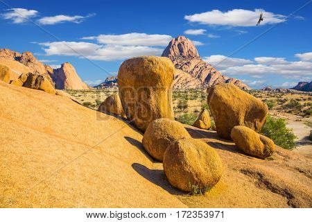Desert Namib, Spitzkoppe, Namibia. Huge granite stones and rocks on a background of blue sky. Concept of extreme and ecological tourism