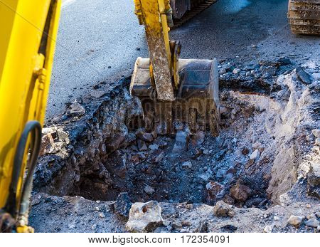 Working mini excavator Tractor Digging street city