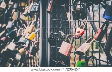 Red Heart Shape Padlock Hanging on the Bridge of Love
