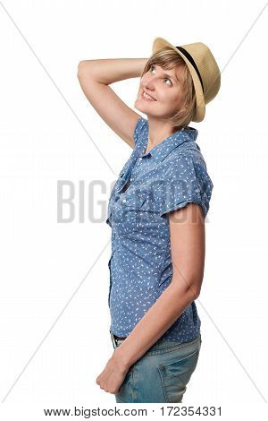 Smiling woman wearing summer straw fedora hat looking up at blank copy space, isolated on white background