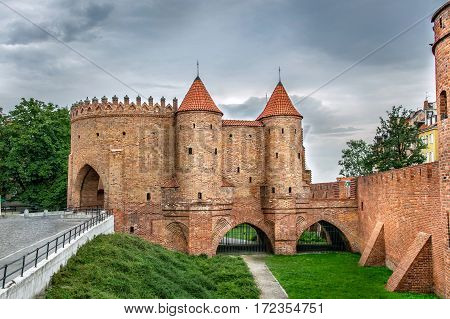 View on Barbakan walls and towers on a cloudy day Warsaw Poland Old Town