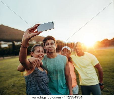 Group Of Runners Taking Selfie At Park