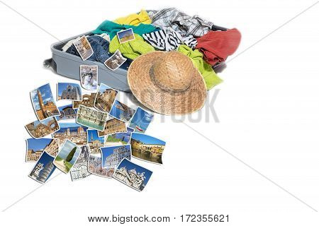 Studio shot of a suitcase with scattered clothing and straw hat. Photos of Tuscany (Italy) landmarks are lying in front of the suitcase. Everything is on a white background.