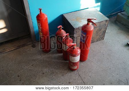 carbon dioxide fire extinguishers in the warehouse before re-checking