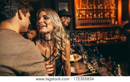 Loving young couple at club. Young man and woman having good time at nightclub.