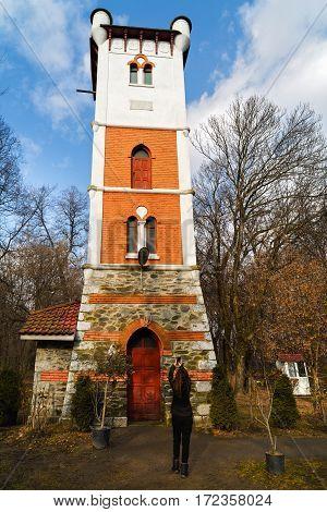woman tourist traveling through Romania. Fire tower in Targu Jiu