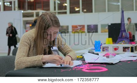Woman using 3D printing pen. Future and technology concept