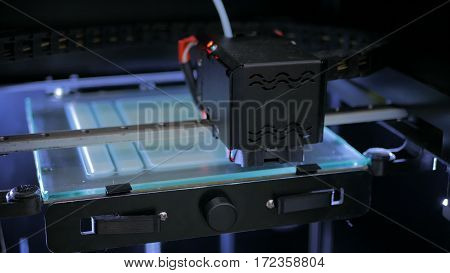 Three dimensional printing machine. 3D printer during work
