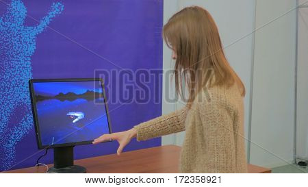 Woman playing motion capture video game. Future and technology concept