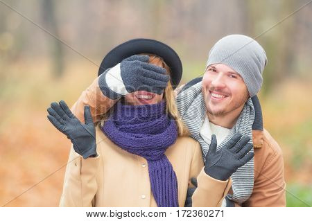 Young and cute couple enjoying in nature / park.