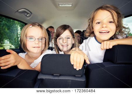Family of five is sitting inside their car