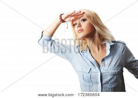 Attractive business woman holding her hand above her eyes as if she's looking off into the distance. Set on white background.