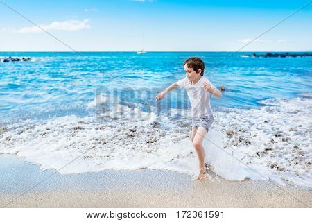 Happy 7 Years Boy Child Playing On The Beach