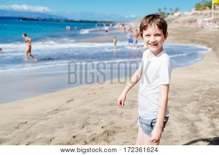Happy 7 Years Boy Child Walking On The Beach.