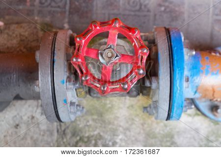 top view on old red hand wheel of valve