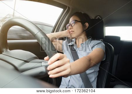 Asian glasses woman boring bad traffic jam on rush hours Business woman driving a car. exhausted tired for overworked concept.