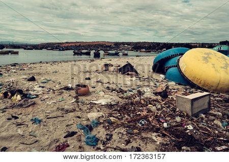 Mui Ne - January 2017: Garbage and basket boats on the beach.