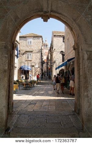 Tourists Walking In The Narrow Alley Of Korcula