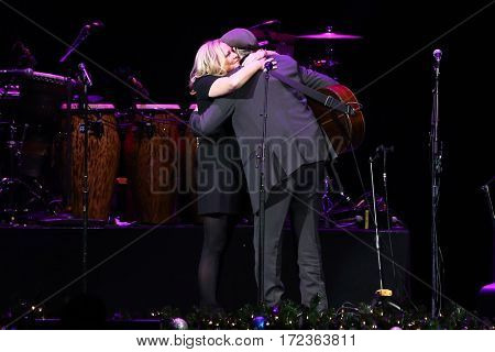 BROOKLYN, NY-DEC 9: James Taylor hugs his wife and backup singer, Kim Smedvig, at WCBS-FM 101.1's Holiday in Brooklyn at Barclays Center on December 9, 2016 in Brooklyn, New York.