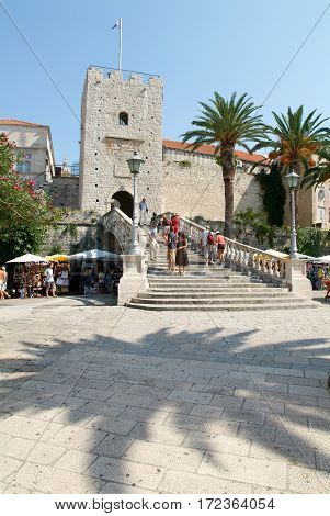 Tourists Walking In Front Of The Castle At Korcula