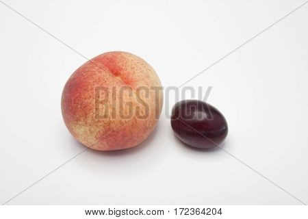 Peach And Plum On A White Background