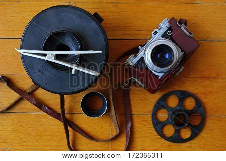 Analog photography equipment with wood background. Vintage composition.