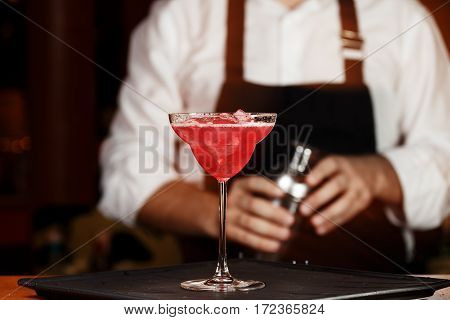 Barman In Making Cocktail At A Nightclub. Nightlife Concept. No Face. Pouring Into Glass