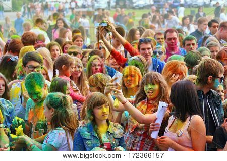 TULA RUSSIA - JUNE 13 2016: Young people at music concert dedicated to festival of colors Holi on June 13 2016 in Tula Russia