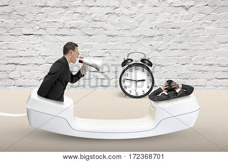 Telephone Handset With Businessman Using Speaker Yelling At Another