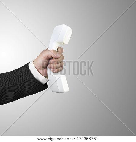 Hand Holding White Telephone Handset