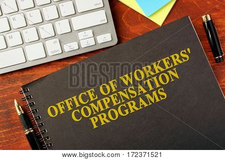 Book with title Office of Workers' Compensation Programs (OWCP).