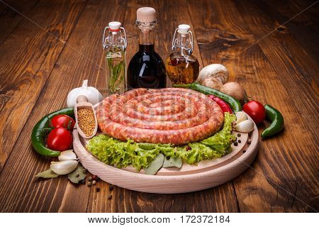 Pork Sausage On Wooden Cutting Board