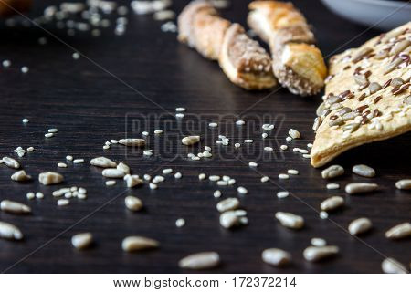Puff pastries with sunflower seeds sesame seeds and flax. Small depth of focus