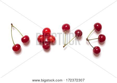 Ripe juicy yellow-red cherry. Word love laid out cherries isolated on a white background ripe summer berries.