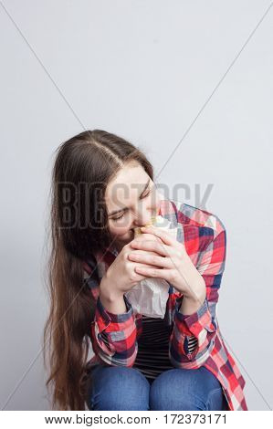 Girl greedily eat shawarma because of hunger