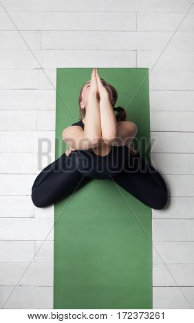 Girl Performs Asana To The Disclosure Of The Pelvis From Yoga