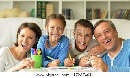 big happy family drawing together at home, have fun